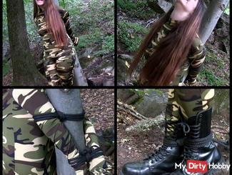 Catsuit soldier tied to a tree