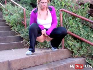 Pee on tall staircase in public