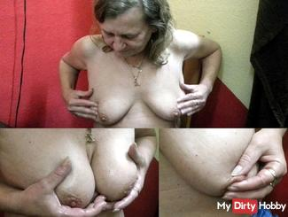 Patrizia kneads her tits and nipples