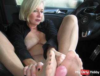 Nylon footjob in the car