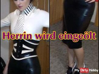 Herrin is oiled in latex