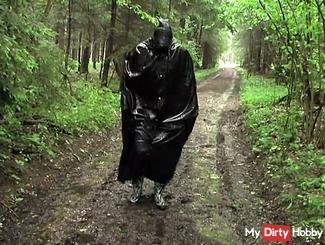 Rainfun competely dressed in latex and rubberboots