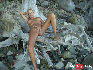ON THE BEACH WITH DILDO AND HAND
