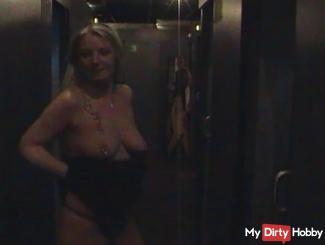 Stripping in a sex shop ...