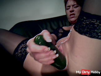 Pussy stretching with huge cucumber