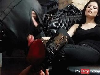 The naked slave licks my boots