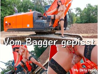 pissing from excavator