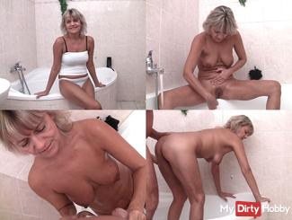 In the bathroom fucked from behind