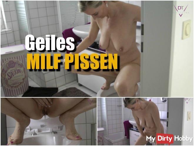 Horny MILF pissing!