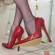 Extreme high heels in the bathroom