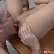oral orgasm on the kitchen table