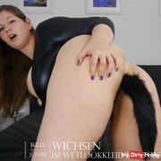 Jerked in wetlookdress and with foxtail