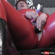 Selffuck in catsuit and rubber boots