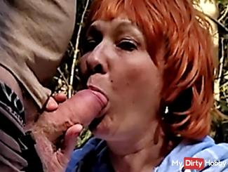 Blow job and sperm in the mouth, red-haired in the forest.
