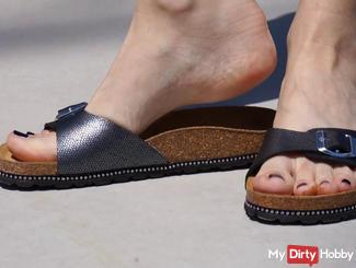 Bare feet on concrete