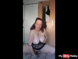 In the bathroom fucked with a dildo