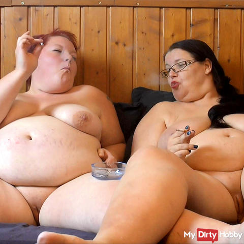 Christmas video 11 - buxom lesbians smoke in bed