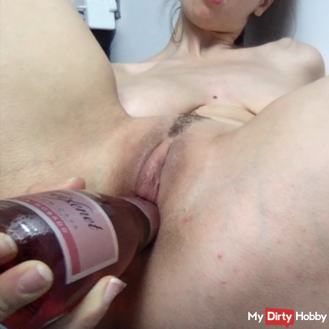 Masturbating with a champagne bottle