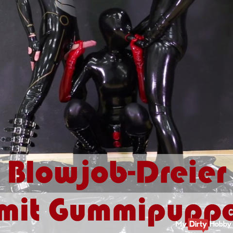 Rubber doll blows in a threesome