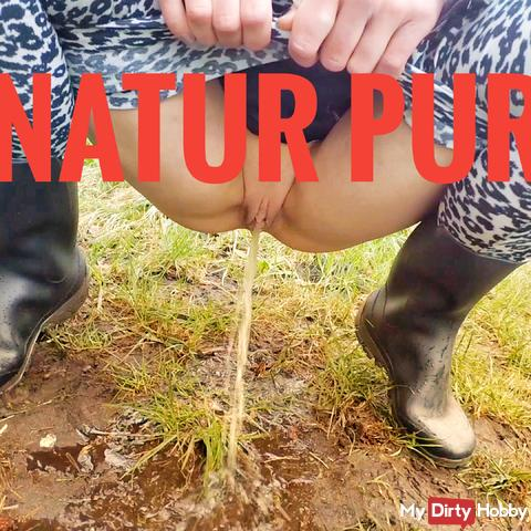 Pure nature in rubber boots pissing almost in the pants