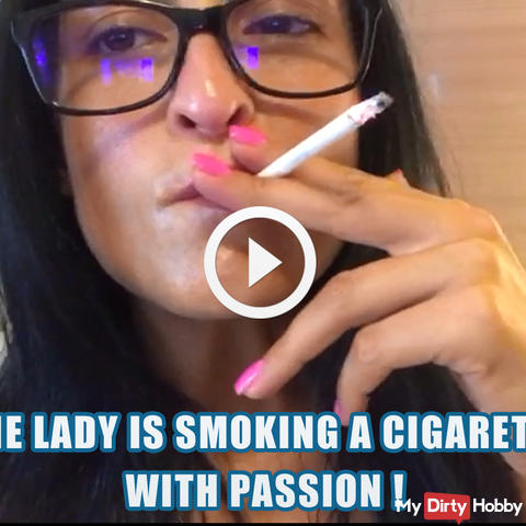 The lady is smoking a cigarette with passion !