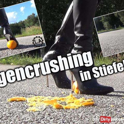 Orange crushing boots with metal heel
