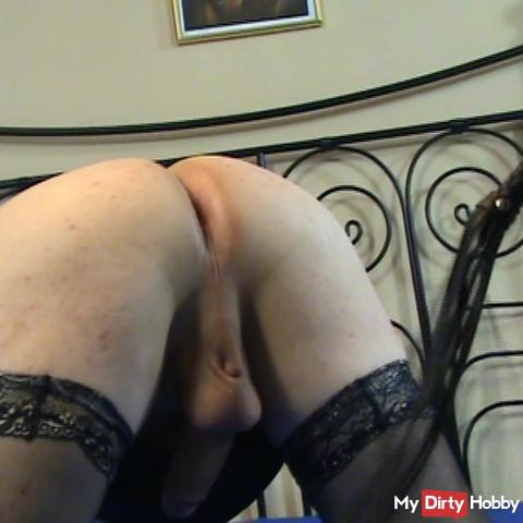 Crossdresser kneeling spanked the ass and the tail