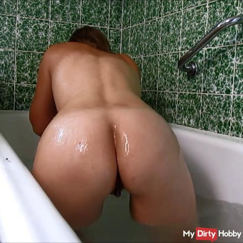 Dildo fucking in the bathtub