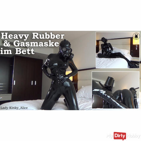 Heavy rubber & gas mask in bed