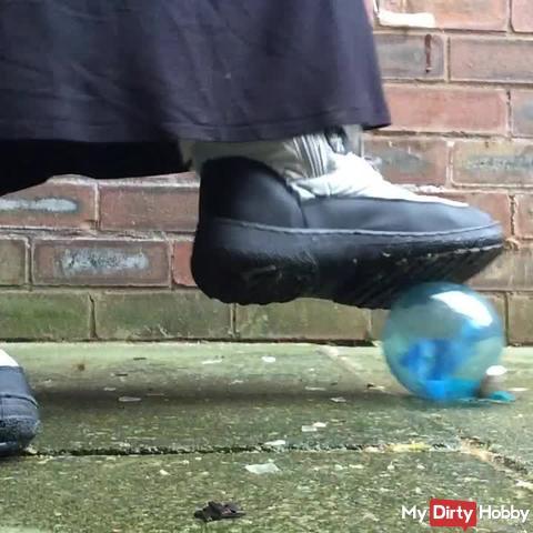 Glass ball crush Snow boot fetish stomp