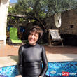 Wetlook Catsuit and dildo in the pool