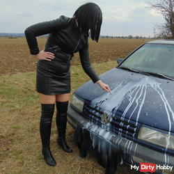 Leather MILF at dirty car