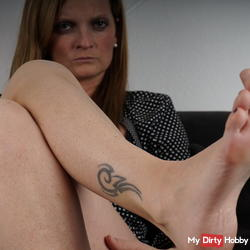 on the couch with bare feet