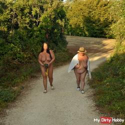 two buxom Lesbians go naked walk 1