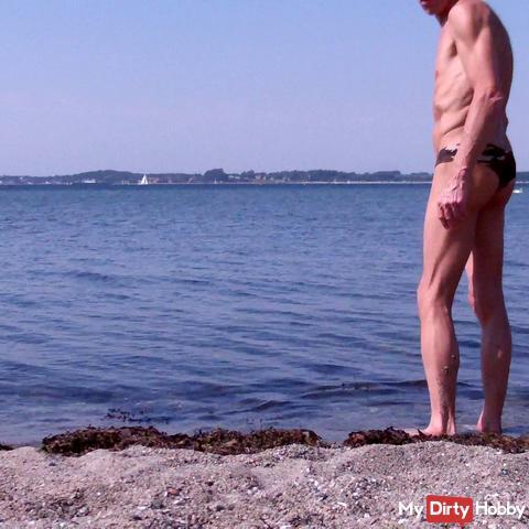 In Mini thong on the beach