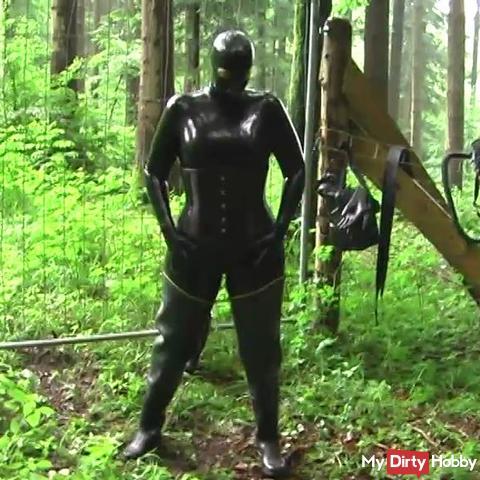 Bizarre rainwear and latex in the woods