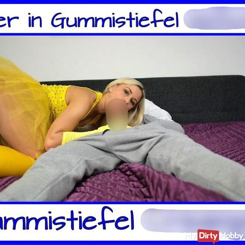 User cream**e fi** in Gummistiefel