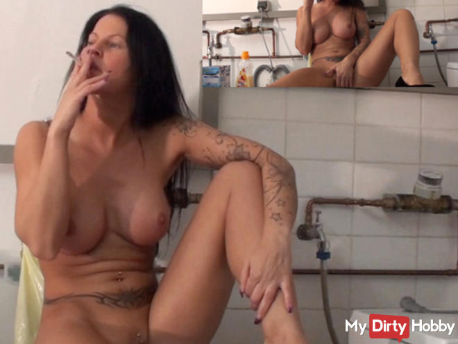Horny nude smoking in the laundry room!