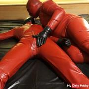 Latex Danielle in catsuit have latex masturbating games with his slave