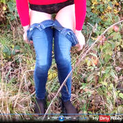 Sexy jeans Piss at the forest walk