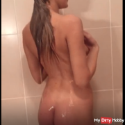 Beautiful young woman after shower make and play in bed