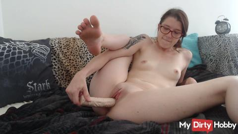 Ellie fingers herself and uses dildo