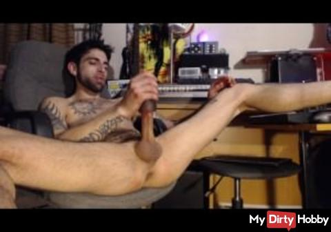 sexy stud stroking cock in computer chair until cum at end