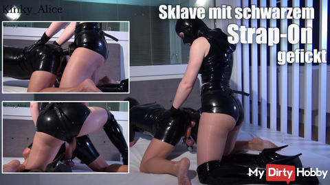 Slave fucked with black strap-on