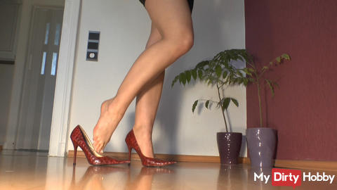 knell in front of my red high heels