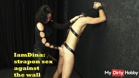 Strapon sex against the wall