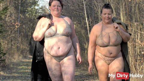 Lesbians walking in lingerie in the woods